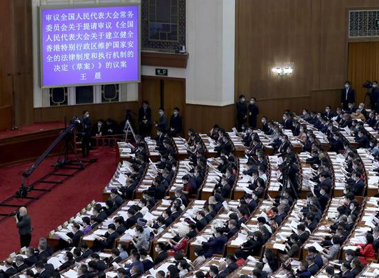 The third session of the 13th National People's Congress (NPC) opens at the Great Hall of the People in Beijing, capital of China, May 22, 2020. (Xinhua/Liu Weibing)