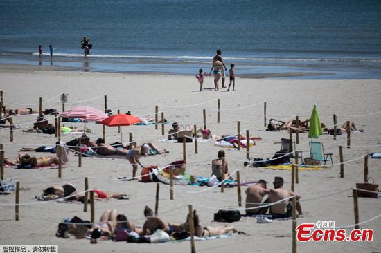 In pics: Social distancing at beach in France