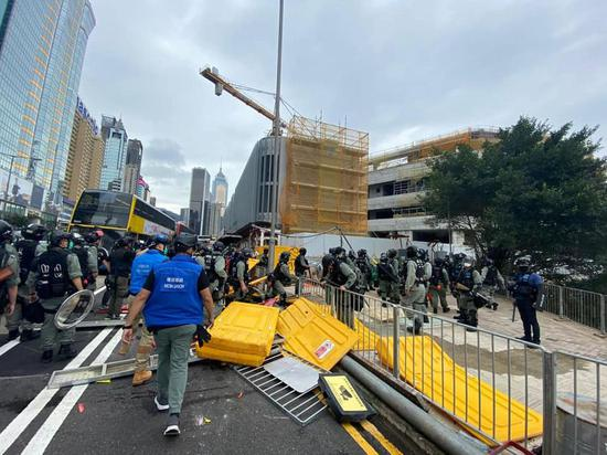 Hong Kong police arrest at least 180 rioters, several officers injured