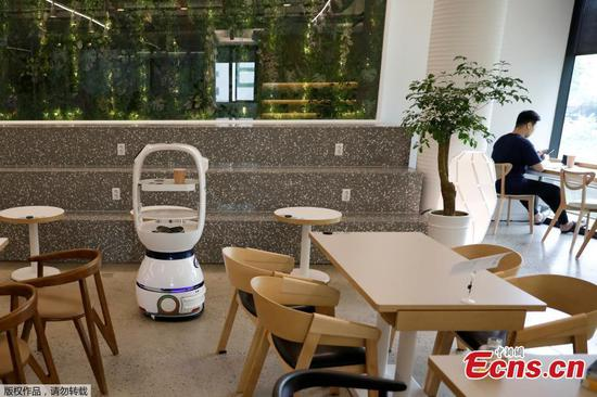 Social-distancing cafe uses robots to make and serve the coffee