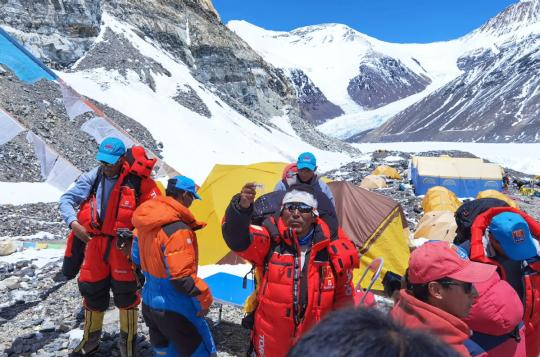 Members of a Chinese team set out from a camp at an altitude of 6,500 meters on Mount Qomolangma in the Tibet autonomous region on May 24, 2020. They are scheduled to reach the summit of the world's highest mountain on Wednesday. (Photo/Xinhua)