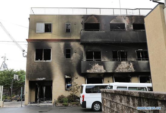Photo taken on July 19, 2019 shows a Kyoto Animation studio building after an arson attack in Kyoto, Japan. The motive behind an alleged arson attack on a studio of Kyoto Animation Co. in western Japan, which killed 33 people a day earlier, may have been the theft of ideas, sources said Friday. Local media quoting investigative sources, said that a 41-year-old man apprehended over the alleged arson attack told police he started the fire at the three-story studio because the company