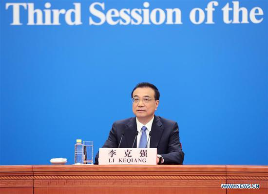 Chinese Premier Li Keqiang meets the press after the closing of the third session of the 13th National People's Congress at the Great Hall of the People in Beijing, capital of China, May 28, 2020. Li took questions from Chinese and foreign reporters via video link. (Xinhua/Liu Weibing)