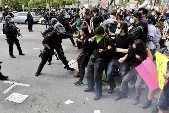 U.S. Los Angeles County extends curfew amid civil unrest