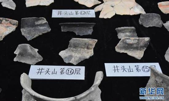 Pictured are items unearthed from the 8,000-year-old prehistoric shell mound in Yuyao, East China's Zhejiang province. (Photo/Xinhua)