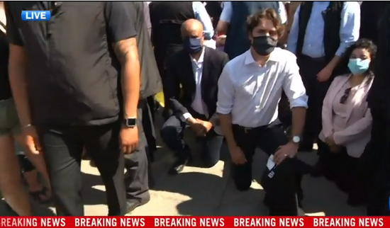 A screenshot taken from CTV's live broadcast shows that Canadian Prime Minister Justin Trudeau (C) and his ministers take a knee in solidarity with the demonstrators who are marching against racism and police brutality in Ottawa, Canada, on June 5, 2020. (Xinhua)