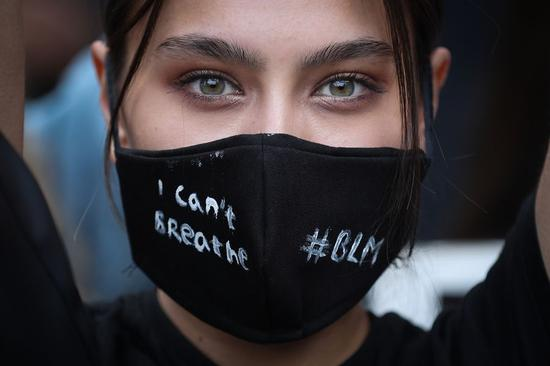 A demonstrator participates in a Black Lives Matter protest in Brussels, Belgium, June 7, 2020. (Xinhua/Zheng Huansong)