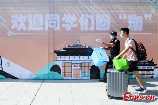 Universities' graduating students back on campus in Wuhan