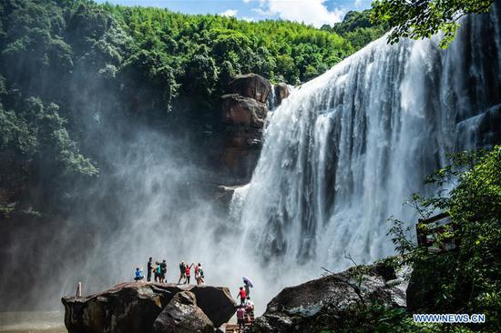 Tourists visit Chishui Waterfall in Guizhou, SW China