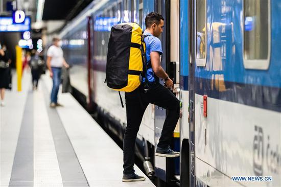 Passengers seen at Berlin Central Train Station as travel warnings lifted