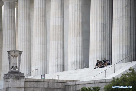 People sit on the steps of the Lincoln Memorial in Washington, D.C., the United States, on June 22, 2020. U.S. COVID-19 deaths surpassed 120,000 on Monday with nearly 2.3 million infections, while new cases continue to increase across the country over three months into the pandemic. (Xinhua/Liu Jie)