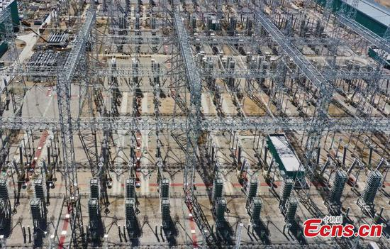China's first ultra-high voltage transmission line for clean energy under construction
