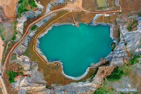 Open-pit mine becomes pond after afforestation