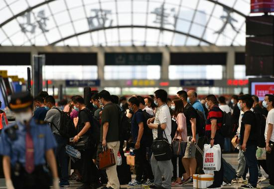 Passengers line up to check in at the Tianjin west railway station in North China's Tianjin, June 6, 2020. [Photo/Xinhua]