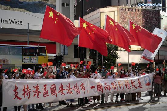 Hong Kong citizens celebrate passage of law on safeguarding national security in HK