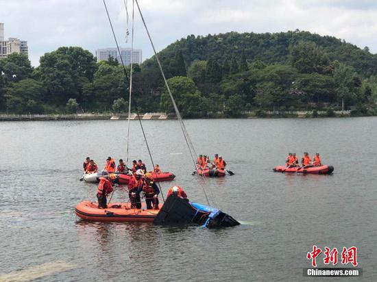 18 rescued after bus falls into reservoir in SW China