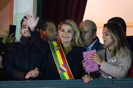 Bolivia's interim president tests positive for COVID-19