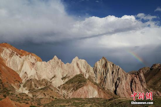 Rainbow over 'Alien Valley' in Zhangye, Gansu