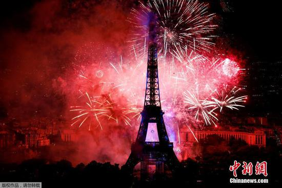 Fireworks light up sky over Eiffel Tower to celebrate Bastille Day