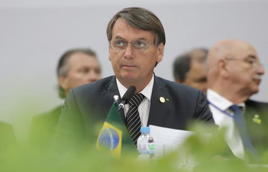 File photo taken on Dec. 5, 2019 shows Brazilian President Jair Bolsonaro (Front) attending a conference in Bento Goncalves, Brazil. (Xinhua/Rahel Patrasso)