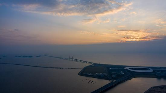 Aerial photo taken on Oct. 24, 2019 shows a morning view of an artificial island of the Hong Kong-Zhuhai-Macao Bridge, south China. (Xinhua/Cheong Kam Ka)