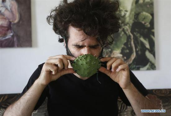 Palestinian artist makes face mask from cactus near Nablus