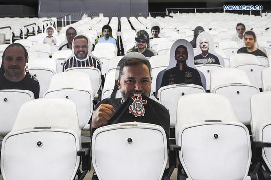 Cutout photos of fans seen on stand at Arena Corinthians in Sao Paulo
