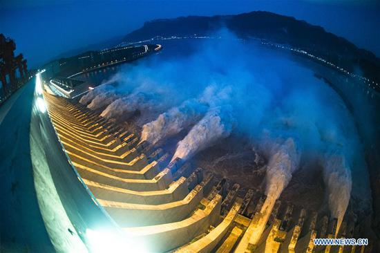 Photo taken on July 19, 2020 shows floodwater being discharged from the Three Gorges Dam in central China's Hubei Province. The second flood of China's Yangtze River this year has smoothly passed the Three Gorges Dam on Sunday as the inflow into the reservoir has decreased. The Three Gorges reservoir saw an inflow of 46,000 cubic meters per second at 8 p.m. Sunday, compared with a peak of 61,000 cubic meters per second, which appeared at 8 a.m. Saturday and lasted for 18 hours. (Xinhua/Xiao Yijiu)