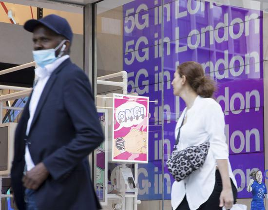 Photo taken on July 20, 2020 shows an advertisement for 5G at a Three store in London, Britain. (Photo by Tim Ireland/Xinhua)