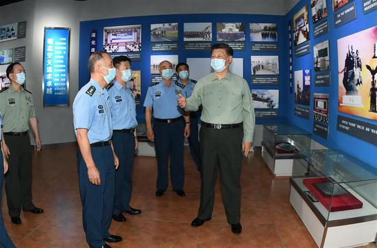 Xi inspects PLA aviation university ahead of Army Day