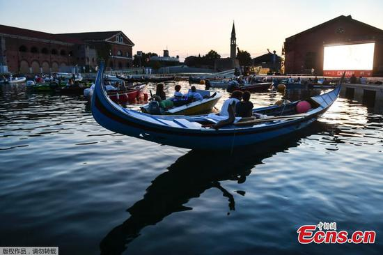 Floating movie theater with socially distant boats set in Venice