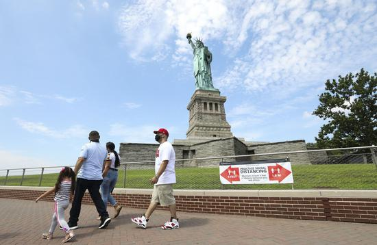Visitors tour the Liberty Island in New York, the United States, July 20, 2020. (Xinhua/Wang Ying)