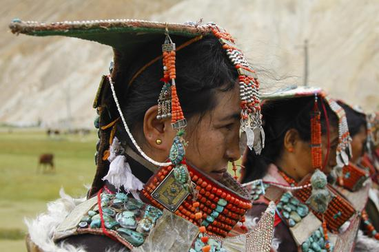 Traditional peacock costume in Tibet's Burang County