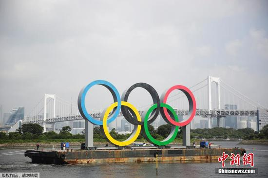 The giant Olympic rings in Tokyo being temporarily removed for maintenance