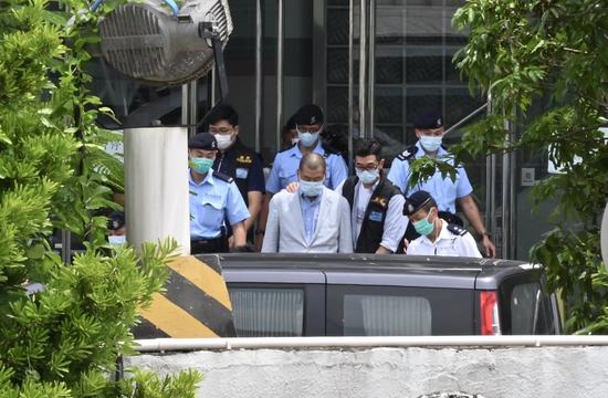 Jimmy Lai Chee-ying is taken by the police to the headquarters of Apple Daily for investigation in Hong Kong, south China, Aug. 10, 2020. (Photo/Xinhua)