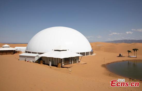 Visit 'star hotel', enjoy desert scene