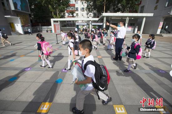 Beijing imposes mandatory mask-wearing at schools