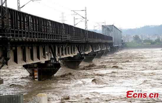 Cargo train drives onto bridge to avoid its collapse in floods