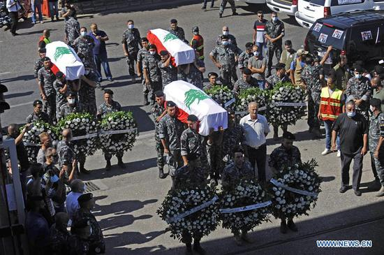 Funeral of firefighters killed during explosions held in Beirut