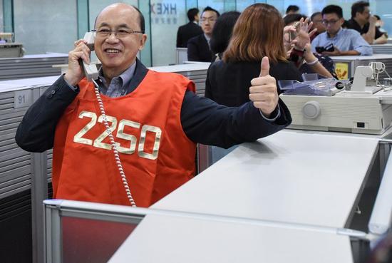 HKEX posts record high half-year net profit, revenue