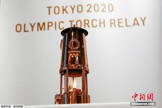 Tokyo Olympic flame on display at Japan Olympic Museum