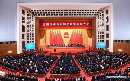 中国举行会议赞扬COVID-19榜样
