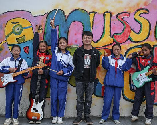 Teacher energizes village children with rock and roll music