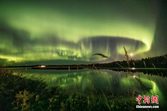 Dazzling northern lights illuminates sky