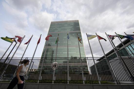A woman walks past the United Nations headquarters in New York, the United States, Sept. 14, 2020. (Xinhua/Wang Ying)