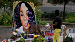 Two U.S. police officers shot in protests over black woman's death