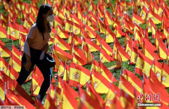 Flags placed in park to pay tribute to COVID-19 victims in Spain