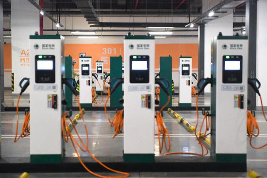 Photo taken on May 16, 2020 shows charging points at a newly-opened electric vehicle charging station in the underground parking lot of the Wukesong sports center in Beijing, capital of China. (Xinhua/Ju Huanzong)
