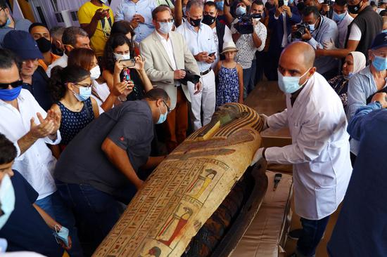 Egypt unveils 59 newly-discovered 2,500-year-old wooden coffins