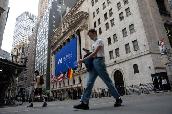 Pedestrians walk past the New York Stock Exchange in New York, the United States, Sept. 25, 2020. (Photo by Michael Nagle/Xinhua)